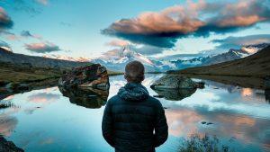 Man thinking about science looking at a lake image Bristol marketing agency