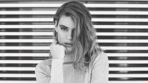 Beautiful woman staring at camera blogger marketing