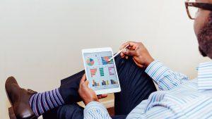 Smart man using an iPad image Bristol marketing agency