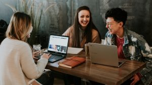 Young people using computers image social media marketingg